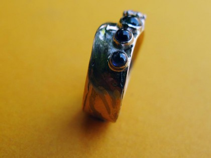 Japanese Mokume Gane and birthstone wedding ring -side view